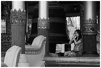 Woman praying next to bell, Shwedagon Pagoda. Yangon, Myanmar ( black and white)