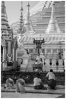 Nuns and couple worshipping at planetary station, Shwedagon Pagoda. Yangon, Myanmar ( black and white)