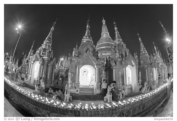 Oil lamps and stupas at dusk, Shwedagon Pagoda. Yangon, Myanmar (black and white)