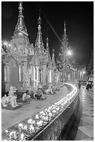 Oil lamps, stupas and shrines at night, Shwedagon Pagoda. Yangon, Myanmar ( black and white)