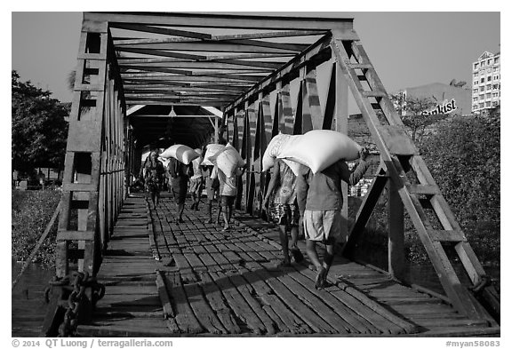 Workers unload bags of rice, Sinodan pier. Yangon, Myanmar (black and white)