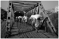 Workers unload bags of rice, Sinodan pier. Yangon, Myanmar ( black and white)