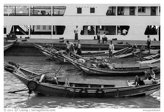 Long-tail boats and ferry, Sinodan pier. Yangon, Myanmar (black and white)