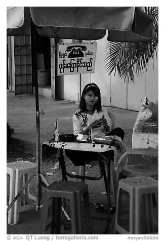 Phone booth operator. Yangon, Myanmar (black and white)