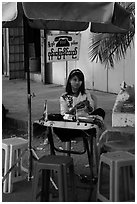 Phone booth operator. Yangon, Myanmar ( black and white)