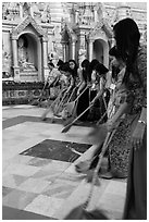 Women sweeping platform, Shwedagon Pagoda. Yangon, Myanmar ( black and white)