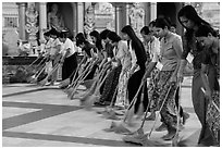 Women lining up to sweep the platform, Shwedagon Pagoda. Yangon, Myanmar ( black and white)