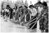 Row of women sweeping, Shwedagon Pagoda. Yangon, Myanmar ( black and white)