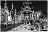 Praying on the platform at night. Yangon, Myanmar ( black and white)
