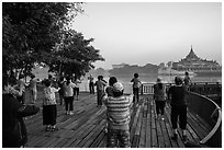 Group practising Tai Chi near Karawiek Hall at sunrise, Kandawgyi Lake Park. Yangon, Myanmar ( black and white)