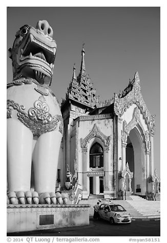 Western Stairway entrance guarded by chinthes. Yangon, Myanmar (black and white)