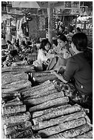 Women selling wood ground to make thanaka. Bagan, Myanmar ( black and white)