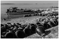 Unloading jars on the Ayeyarwaddy River. Bagan, Myanmar ( black and white)