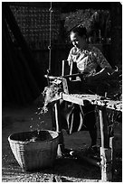 Villager processing harvest. Bagan, Myanmar ( black and white)