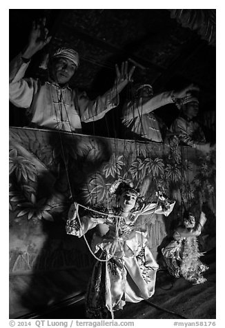 Marionettes handled by puppeteers. Bagan, Myanmar (black and white)