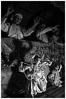 Marionettes handled by puppeteers. Bagan, Myanmar ( black and white)
