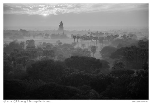 Bagan tower and sun above morning mist. Bagan, Myanmar (black and white)