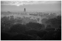 Bagan tower and sun above morning mist. Bagan, Myanmar ( black and white)