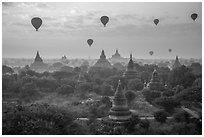 Hot air ballons above temples at sunrise. Bagan, Myanmar ( black and white)