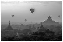 Aerial view of ancient temples and hot air ballons at sunrise. Bagan, Myanmar ( black and white)