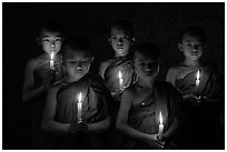 Young buddhist novices holding candles. Bagan, Myanmar ( black and white)