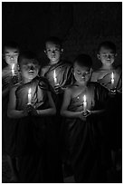 Group of buddhist novices holding candles. Bagan, Myanmar ( black and white)