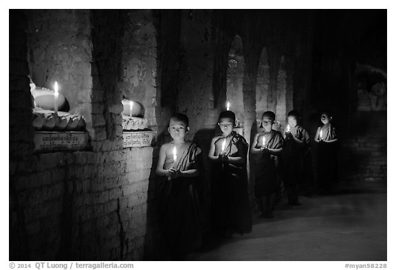Buddhist novices in temple illuminated with candles. Bagan, Myanmar (black and white)