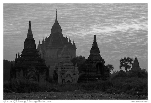 Temples profiled against brilliant sunrise sky. Bagan, Myanmar (black and white)