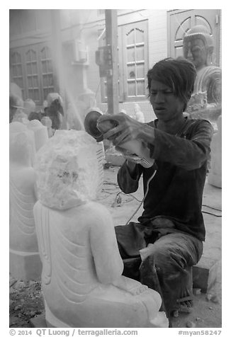 Man carving marble buddha statue with grinder. Mandalay, Myanmar (black and white)