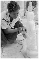 Stone sculptor finishing buddha statue. Mandalay, Myanmar ( black and white)