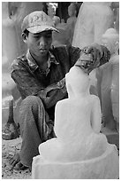Sculptor carving buddha statue out of a block of white marble. Mandalay, Myanmar ( black and white)