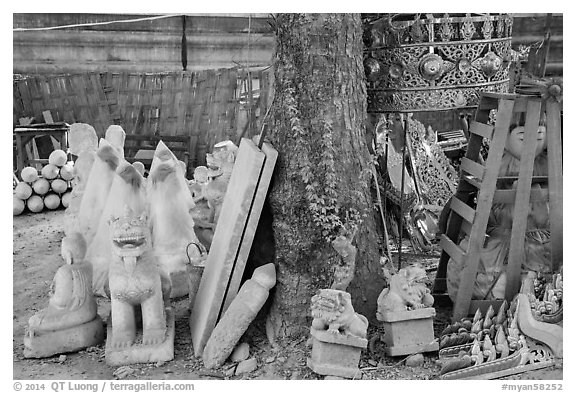 Assortment of sculptures, Marble street. Mandalay, Myanmar (black and white)