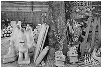 Assortment of sculptures, Marble street. Mandalay, Myanmar ( black and white)