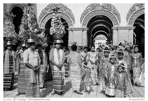 Young children and families gathering for noviciation ceremony, Mahamuni Pagoda. Mandalay, Myanmar (black and white)
