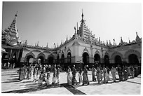 Novices and families walk in procession during Shinbyu ceremony, Mahamuni Pagoda. Mandalay, Myanmar ( black and white)
