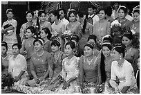 Women pose during novitiation ceremony, Mahamuni Pagoda. Mandalay, Myanmar ( black and white)