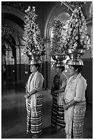 Women carry elaborate flower offerings on their head, Mahamuni Pagoda. Mandalay, Myanmar ( black and white)