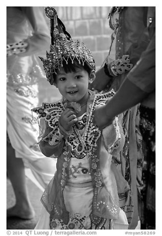 Young girl dressed in glittering attire during novitiation, Mahamuni Pagoda. Mandalay, Myanmar (black and white)
