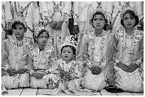 Girls and boy dressed in glittering clothes and make-up to look like princes, Novitiation, Mahamuni Pagoda. Mandalay, Myanmar ( black and white)
