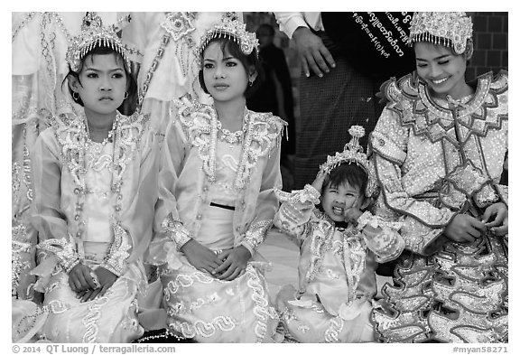Girls with make-up and princely attire reacting during Noviciation, Mahamuni Pagoda. Mandalay, Myanmar (black and white)