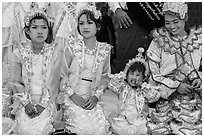 Girls with make-up and princely attire reacting during Noviciation, Mahamuni Pagoda. Mandalay, Myanmar ( black and white)