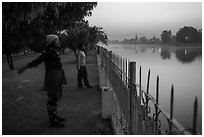 Women exercising next to Mandalay Fort at dawn. Mandalay, Myanmar ( black and white)