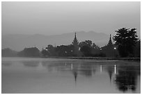Pagodas reflected in moat at dawn, Mandalay Fort. Mandalay, Myanmar ( black and white)
