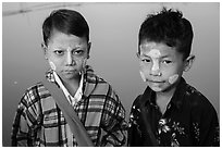 Boys wearing thanaka paste. Mandalay, Myanmar ( black and white)