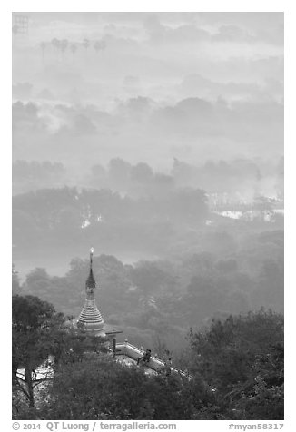 Stupa on Mandalay Hill overlooking misty plain. Mandalay, Myanmar (black and white)