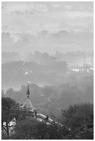 Stupa on Mandalay Hill overlooking misty plain. Mandalay, Myanmar ( black and white)