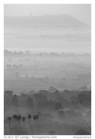 Ridges in mist at sunrise seen from Mandalay Hill. Mandalay, Myanmar (black and white)