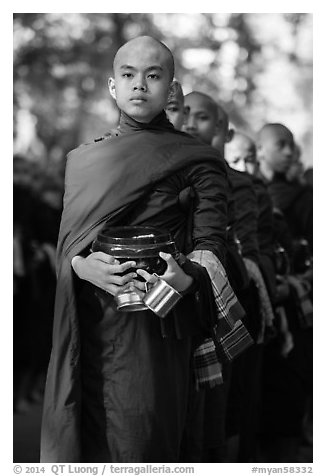 Monks stand in line before lunch, Mahagandayon Monastery. Amarapura, Myanmar (black and white)