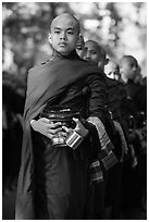 Monks stand in line before lunch, Mahagandayon Monastery. Amarapura, Myanmar ( black and white)