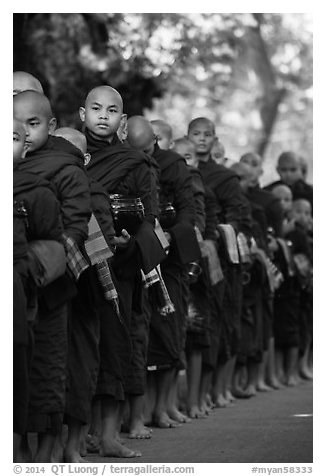 Monks lining up with alms bowls, Mahagandayon Monastery. Amarapura, Myanmar (black and white)